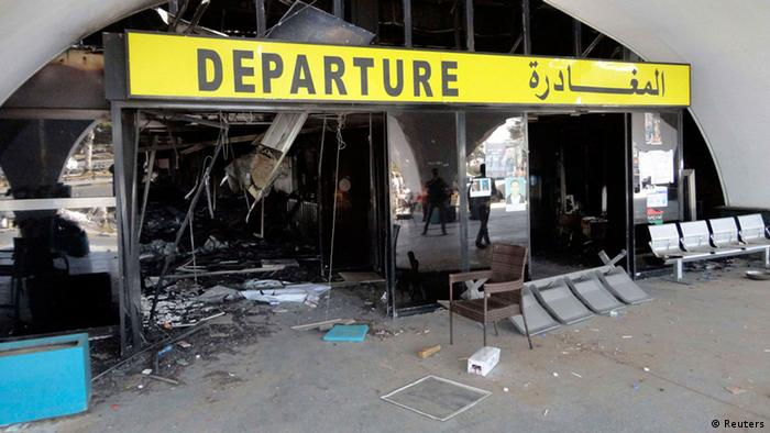 A general view is seen of the passenger terminal of Tripoli international airport August 24, 2014. Unidentified war planes attacked targets in Libya's capital Tripoli on Sunday, residents said, hours after forces from the city of Misrata said they had seized the main airport. Tripoli residents heard jets followed by explosions at dawn but no more details were immediately available. photo: REUTERS/Aimen Elsahli)
