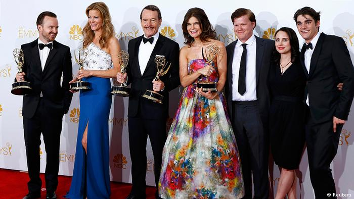 Cast members of Breaking Bad pose with their Emmy Awards.