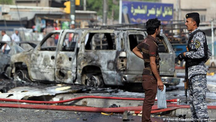 A scene shows the aftermath of a suicide bombing in Iraq