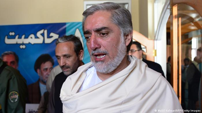 Afghan presidential candidate Abdullah Abdullah (R) talks with supporters at a gathering on the last day of campaigning, at his residence in Kabul on June 11, 2014 (Photo: WAKIL KOHSAR/AFP/Getty Images)