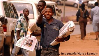 A newspaper seller in Kigali