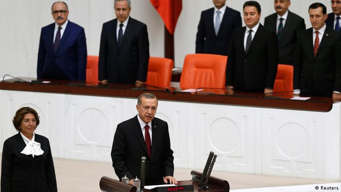 Turkey's President Tayyip Erdogan (front C) attends a swearing in ceremony at the parliament in Ankara August 28, 2014.