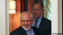 Iranian Foreign Minister Mohammad Javad Zarif (front) and his Russian counterpart Sergei Lavrov walk into a hall during a meeting in Moscow, August 29, 2014. Russia said on Thursday the possibility of lifting sanctions on Iran had emerged thanks to international talks on Tehran's nuclear program and urged all countries involved to show political will to reach a deal. Iranian Foreign Minister Mohammad Javad Zarif will meet his Russian counterpart Sergei Lavrov in Moscow on Friday to discuss the negotiations with six world powers on a decade-old stand-off over the Islamic Republic's nuclear ambitions. REUTERS/Maxim Zmeyev (RUSSIA - Tags: POLITICS ENERGY BUSINESS)