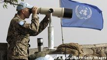 European members of United Nations Disengagement Observer Force (UNDOF) use binoculars to watch the Syrian side of the Golan Heights on August 30, 2014 in the Israeli-occupied Golan Heights, after Syrian rebel fighters took control of the Quneitra checkpoint between Israel and Syria . Philippine UN peacekeepers in the Golan Heights clashed with Syrian rebels , Defence Minister Voltaire Gazmin said in Manila. AFP PHOTO/ AHMAD GHARABLI (Photo credit should read AHMAD GHARABLI/AFP/Getty Images)