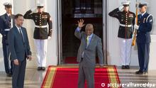 Thomas Thabane, center, waves beside US Chief of Protocol Ambassador Peter Selfridge (L), upon arriving at the North Portico of the White House, in Washington DC, USA, 05 August 2014