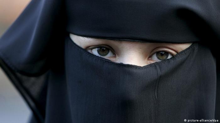 A woman wearing a burqa