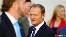 Poland's Prime Minister Donald Tusk walks outside the parliament in Warsaw August 29, 2014. Tusk is seriously considering a proposal that he takes the post of president of the European Council, a Warsaw government spokeswoman said on Thursday, linking his decision to the crisis in neighbouring Ukraine. REUTERS/Filip Klimaszewski (POLAND - Tags: POLITICS)