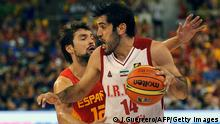 Spain's guard Sergio Llull (L) vies with Iran's forward Samad Nikkhah Bahrami during the 2014 FIBA World basketball championships group A match Iran vs Spain at the Palacio Municipal de Deportes in Granada on August 30, 2014. AFP PHOTO / JORGE GUERRERO (Photo credit should read Jorge Guerrero/AFP/Getty Images)