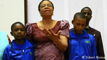 Graca Mandela flanked by two girls, Pili Mohere and Happiness Rhobi, speaks out against child marriage. Photo: Zuberi Mussa