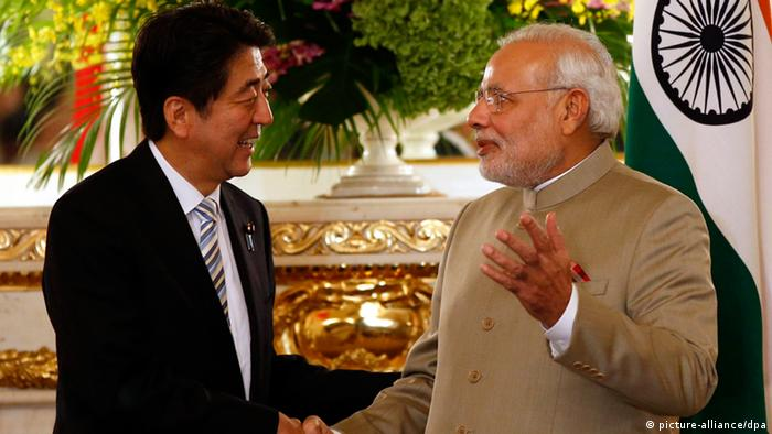 India's Prime Minister Narendra Modi (R) and Japan's Prime Minister Shinzo Abe shake hands before their talks at the state guest house in Tokyo, Japan, 01 September 2014 (Photo: EPA/TORU HANAI / POOL +++(c) dpa - Bildfunk+++)