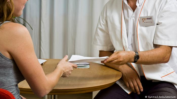 A doctor in a consultation with a woman.