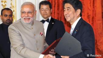 India's Prime Minister Narendra Modi (front L) shakes hands with Japan's Prime Minister Shinzo Abe during a signing ceremony at the state guest house in Tokyo September 1, 2014 (Photo: REUTERS/Shizuo Kambayashi/Pool)