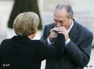 A French kiss on the hand for Germany's new chancellor