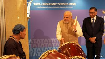 Narendra Modi in Tokio - Headline: PM S DRUM BEATS Caption: TOKYO SEP 2 UNI :- Prime Minister Narendra Modi shares a lighter moment with Japanese ceremonial drummers at the inauguration of the TCS Japan Technology and Cultural Academy in Tokyo Japan on Tuesday UNI PHOTO-12U Date/ Time: 11:41:35 AM Source: UNI City: TOKYO Country: japan