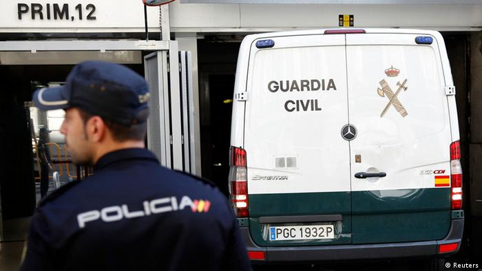 Spanish police officer and a police van