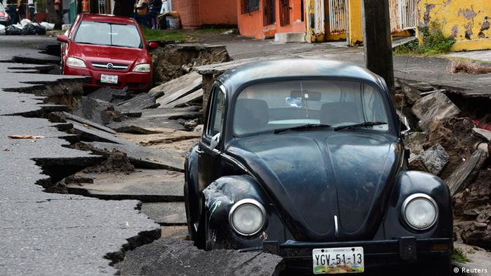 Cars are seen on a street damaged due to heavy rains in Veracruz, Mexico