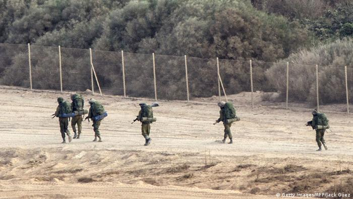 Soldiers walking past Gaza fence (Getty Images/AFP/Jack Guez)