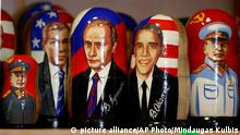 A traditional Russian Matryoshka wooden doll depicting US President Barack Obama, second from right, Russian President, Vladimir Putin, center, U.S. President George W. Bush, second from left, and Leader of the Soviet Union from the mid-1920s until 1953 Joseph Stalin, left, and right, on a display in Tallinn, Estonia, Tuesday, Sept. 2, 2014 (AP Photo/Mindaugas Kulbis)