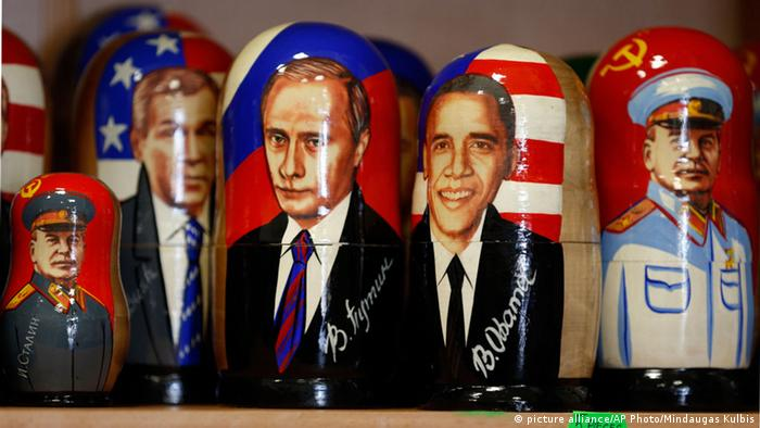 Various leaders depicted on wooden toys symbolize the conflicts of the Cold War