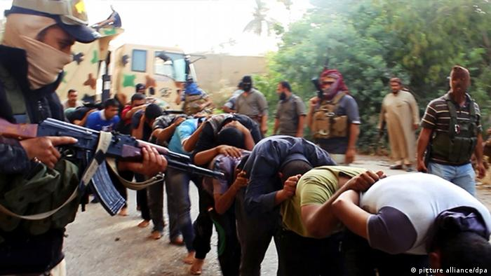 IS fighters Photo: AP Photo via militant website,
