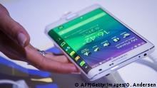A Samsung Galaxy edge is seen at an event in Berlin on September 3, 2014, in advance of the consumer electronics trade fair 'Internationale Funk Ausstellung '(IFA). IFA, one of Europe's biggest showcases of the latest electronic gadgets, is scheduled to open on September 5 and run until September 10, 2014. AFP PHOTO / ODD ANDERSEN (Photo credit should read ODD ANDERSEN/AFP/Getty Images)