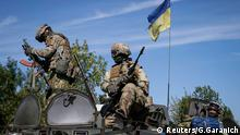 Members of the military special forces sit on an armoured vehicle near Kramatorsk September 4, 2014. NATO's top official accused Moscow outright on Thursday of attacking Ukraine as allied leaders gathered for a summit to buttress support for Kiev and bolster defences against a Russia they now see as hostile for the first time since the Cold War. REUTERS/Gleb Garanich (UKRAINE - Tags: POLITICS CIVIL UNREST MILITARY)