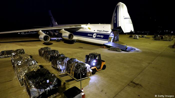 A plane gets its cargo loaded on board