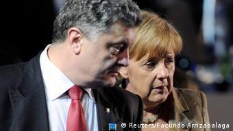 Петр Порошенко и Ангела Меркель на саммите НАТО в Уэльсе