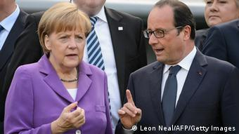 Angela Merkel und Francois Hollande verkrampft (Foto: AFP/Getty Images)