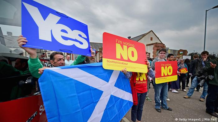 Scotland flag, yes and no banners Photo by Jeff J Mitchell/Getty Images