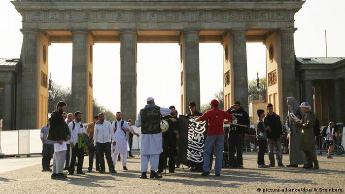 A group of Salafists rallying in front of the Brandenburg gate in Berlin