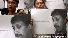 JAKARTA, INDONESIA: Indonesian human rights activists hold posters of Munir, a human right activist who died by poisoning, at the human rights offices in Jakarta, 23 November 2004. The intrigue surrounding the poisoning of Munir deepened further as his colleagues said they had uncovered new clues after quizzing staff on the airplane on which he died. AFP PHOTO/DEWIRA (Photo credit should read DEWIRA/AFP/Getty Images)