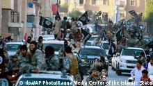 Islamic State fighters parading through Raqqa in 2014