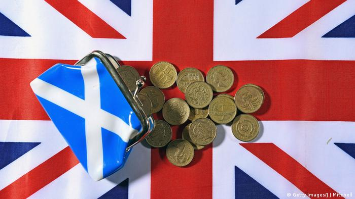 Union Jack flag and coins Photo by Jeff J Mitchell/Getty Images