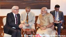 German Foreign Minister Frank-Walter Steinmeier (L) and India's Prime Minister Narendra Modi (2nd R) share a laugh during their meeting in New Delhi September 8, 2014. Steinmeier is on a three-day visit to India. REUTERS/India's Press Information Bureau/Handout via Reuters (INDIA - Tags: POLITICS) ATTENTION EDITORS - NO SALES. NO ARCHIVES. FOR EDITORIAL USE ONLY. NOT FOR SALE FOR MARKETING OR ADVERTISING CAMPAIGNS. THIS IMAGE HAS BEEN SUPPLIED BY A THIRD PARTY. IT IS DISTRIBUTED, EXACTLY AS RECEIVED BY REUTERS, AS A SERVICE TO CLIENTS