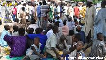 Civilians who fled their homes following an attacked by Islamist militants in Bama, take refuge at a School in Maiduguri, Nigeria, Wednesday, Sept. 3, 2014. A Nigerian senator says thousands of people are fleeing a northeastern city amid conflicting reports that it has been seized by Boko Haram Islamic militants. Sen. Ali Ndume said Tuesday the military is claiming it has repelled the insurgents in fierce fighting for the city of Bama but the stream of refugees indicates otherwise. (AP Photo/Jossy Ola)