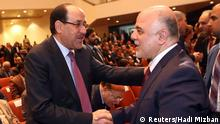 Iraq's Vice President Nouri al-Maliki (L) and new Prime Minister Haider al-Abadi shake hands during the session to approve the new government in Baghdad, September 8, 2014.Iraq's parliament approved a new government headed by Haider al-Abadi as prime minister on Monday night, in a bid to rescue Iraq from collapse, with sectarianism and Arab-Kurdish tensions on the rise. REUTERS/Hadi Mizban/Pool (IRAQ - Tags: POLITICS)
