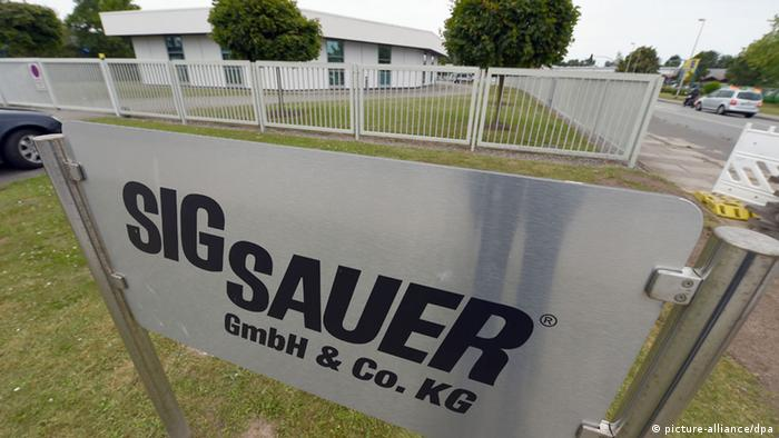 A Sig Sauer sign on the side of a road