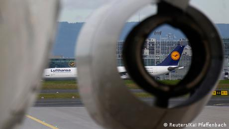 An airplane engine and a Lufthansa plane