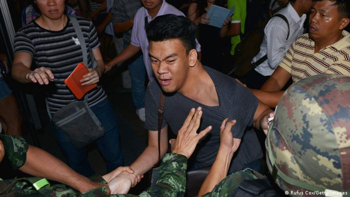 A protester scuffles with army soldiers while resisting arrest after an anti-coup rally on May 23, 2014 in Bangkok, Thailand (Photo: Rufus Cox/Getty Images)
