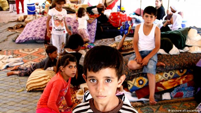 A boy looks into the camera at a refugee camp in Silopi (Photo: EPA)