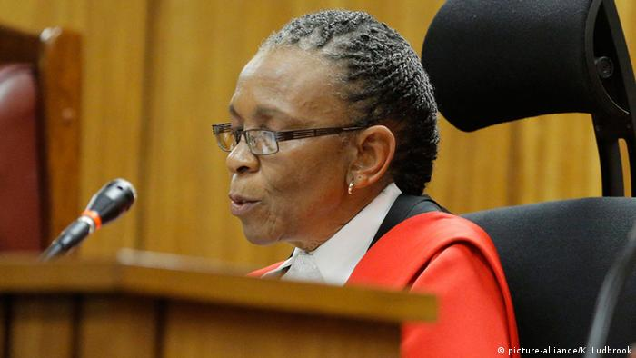 Judge Thokozile Masipa sits before a microphone
