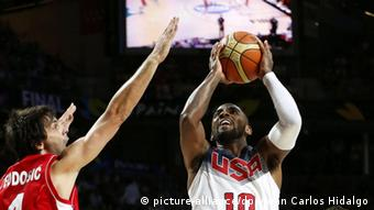 Kyrie Irving of the USA in action against Serbia's Milos Teodosic