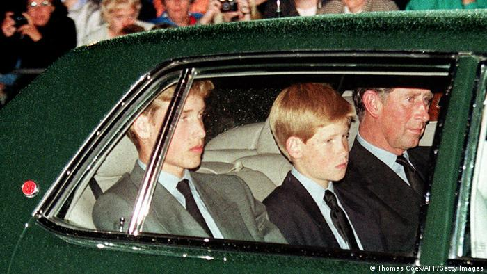 Prince Charles (R), former husband of Diana, their two sons, Harry (C) and William follow the hearse in a limousine as the coffin of Princess of Wales is transported during the funeral (Thomas Coex/AFP/Getty Images)
