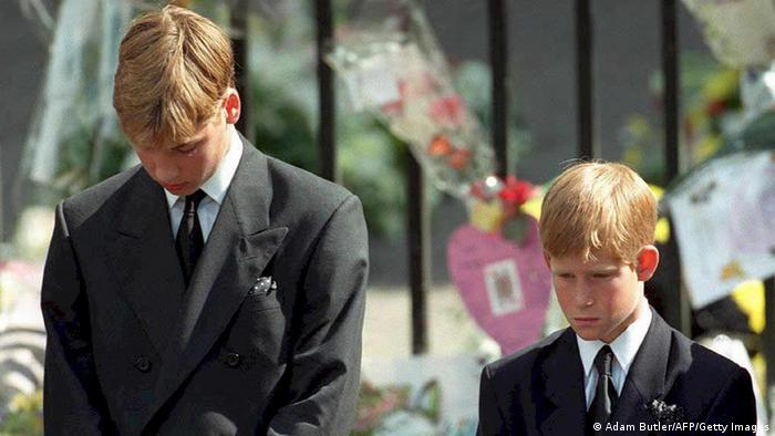 Prince William (left) and Prince Harry, the sons of Diana, Princess of Wales, bow their heads as their mother's coffin is taken out of Westminster Abbey (Adam Butler/AFP/Getty Images)