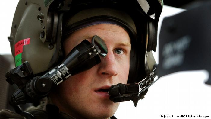 Britain's Prince Harry wearing his monocle gun sight as he sits in the front seat of his Apache Helicopter (John Stillwell/AFP/Getty Images)
