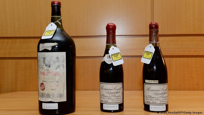 Three bottles of wine used as evidence in the trial of wine dealer Rudy Kurniawan are displayed in Federal Court on December 19, 2013 in New York.