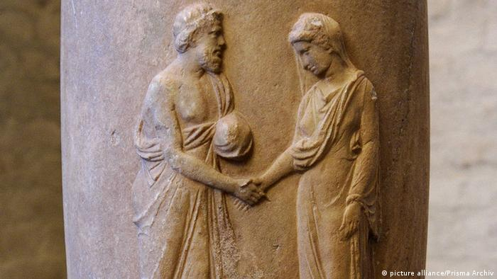 Figures on ancient Greek flask shaking hands