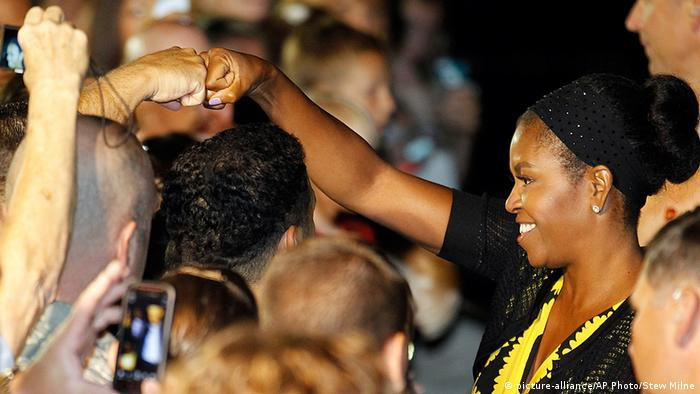 Michelle Obama giving fist bump
