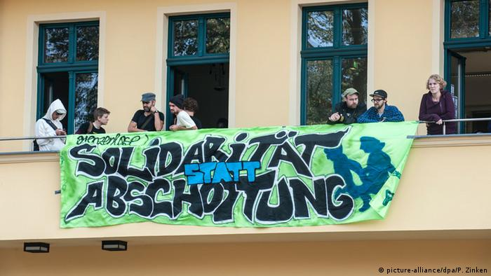 Solidarity instead of separation, reads the sign of the protesters occupying Green Party headquarters